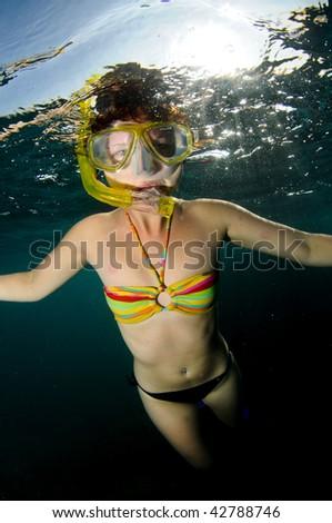 girl snorkeling - stock photo
