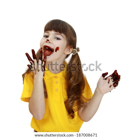 Girl soiled in chocolate licks fingers isolated on white background - stock photo