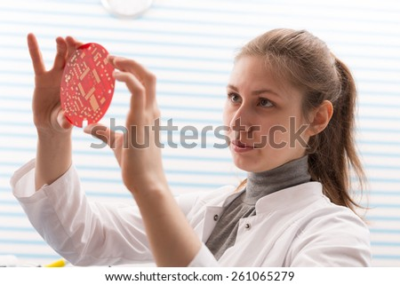 Girl Solder and adjust Electronic Device - stock photo