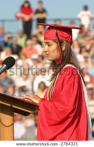 Girl speaking at high school graduation. Editorial use.