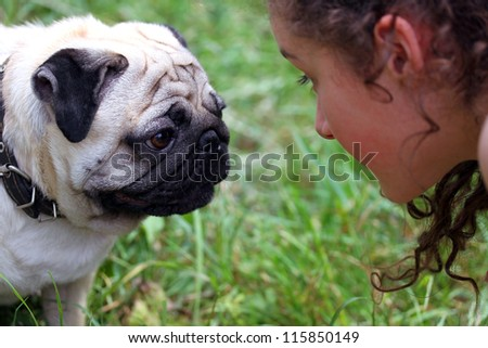 Girl speaking with a dog - stock photo