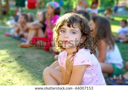 girl spectator little children looking show outdoor park looking camera - stock photo