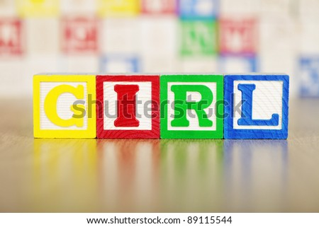 Girl Spelled Out in Alphabet Building Blocks - stock photo