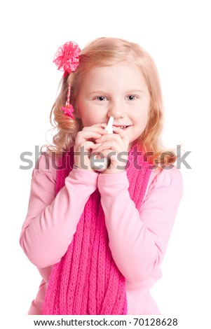girl spraying her nose with nasal spray - stock photo