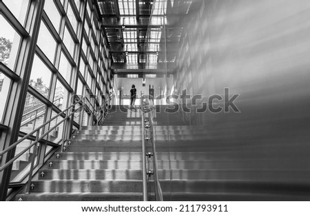 girl stand on the stairway - stock photo