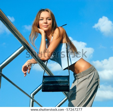 girl, standing at a fence - stock photo