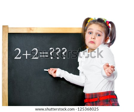 girl standing at the blackboard, isolated