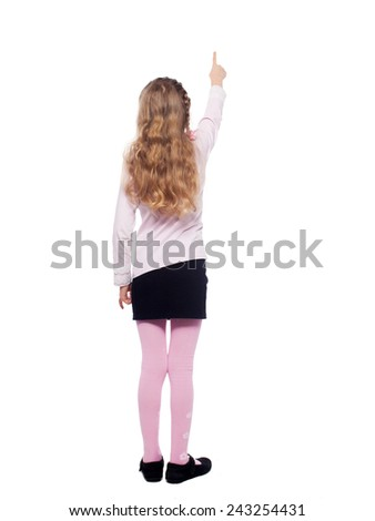 Girl standing back. Girl isolated on white. School child elementary - stock photo