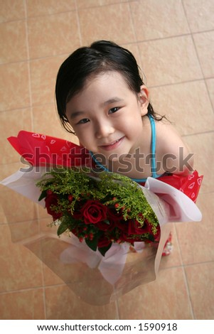 girl standing & holding bouquet of red roses - stock photo