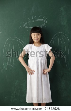 girl standing in front of camera with angel drawing