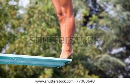 Girl standing on diving board - stock photo