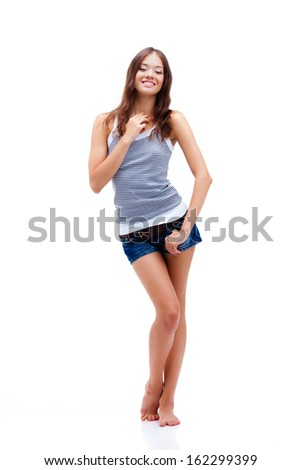 girl standing on white background, wearing shorts