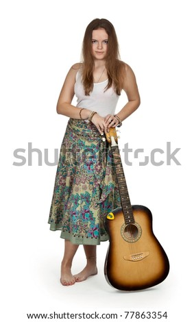 girl stands with acoustic guitar on a white background - stock photo