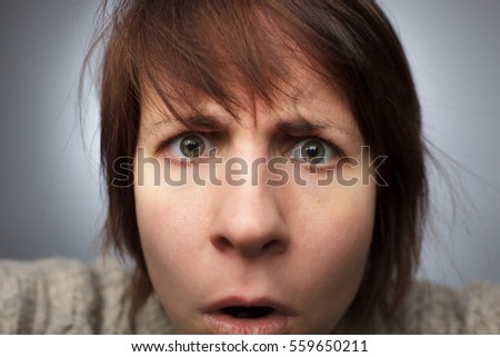 girl stares camera frowning disbelief stock photo (royalty free