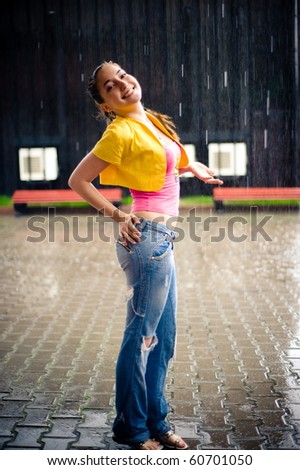 Girl stay under rain drops - stock photo