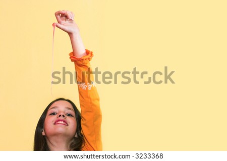 Girl stretching a chewing gum from her mouth - stock photo