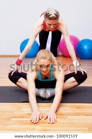 Girl stretching in fitness club
