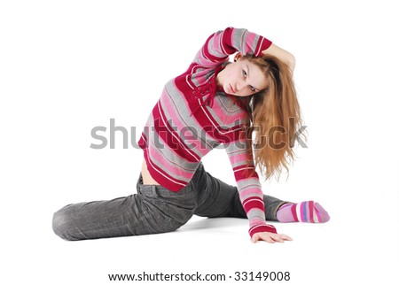 Girl stretching isolated on white - stock photo