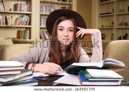 girl student preparing for the exam in the library.