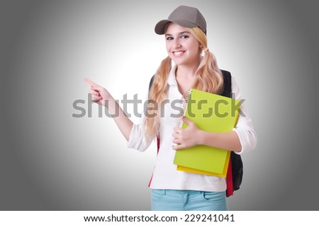 Girl student with books on white - stock photo