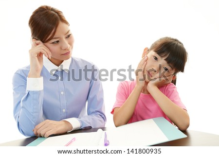 Girl studying at the desk being tired - stock photo