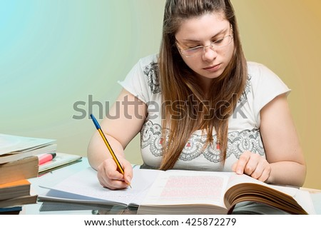 girl studying with pen in hand