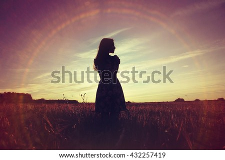 girl sunset field sun glare - stock photo
