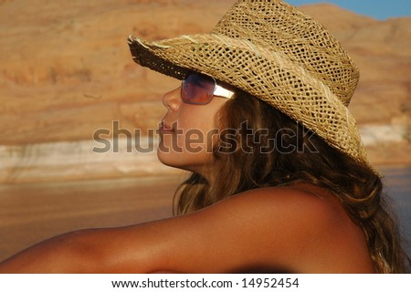 Girl suntanning with hat - stock photo