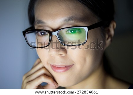Girl surfing on the internet at night - stock photo