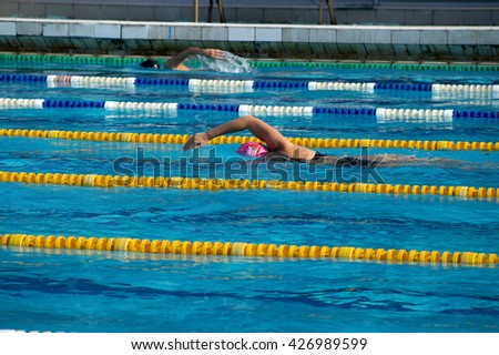 Girl swimmer in the outdoor swimming pool - stock photo