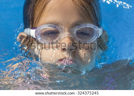 Girl swimming - stock photo