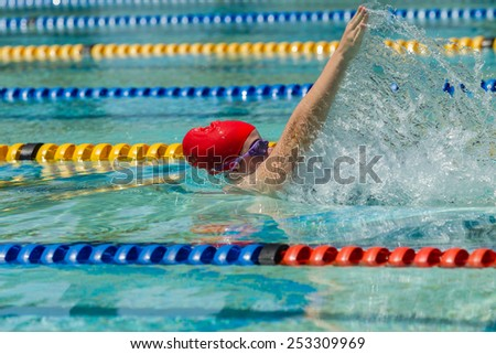 Girl Swimming Race Teen girl swimming race closeup action in pool lanes. - stock photo