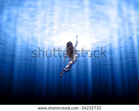 Girl swimming underwater. - stock photo