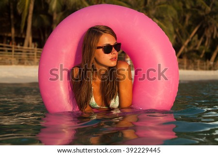 girl swimming with floating tube