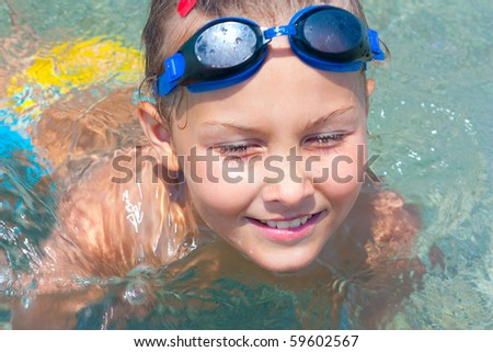 Girl swims in the sea, summer.
