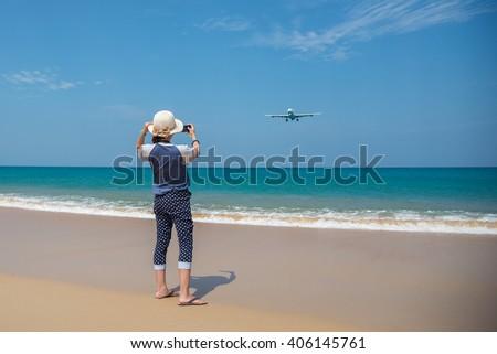 girl take photo on the beach - stock photo
