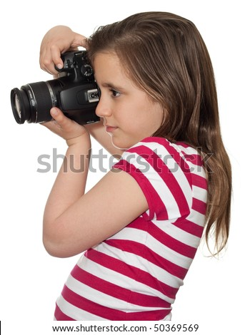 Girl taking a picture with a professional camera isolated on white - stock photo