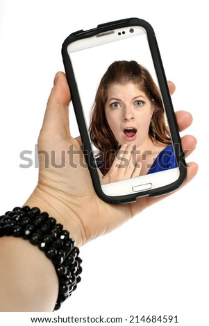 girl taking a selfie on a white background - stock photo