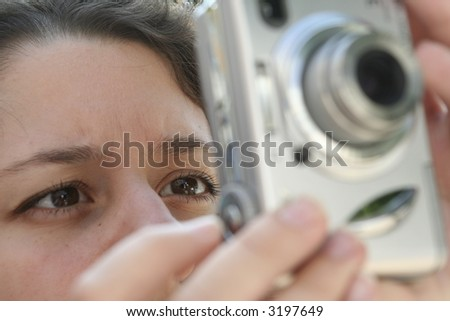 Girl taking a snapshot - stock photo