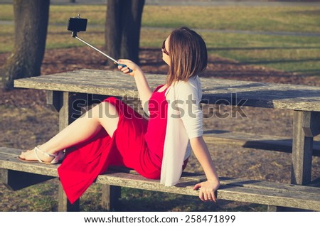 girl taking selfie picture outdoors - stock photo