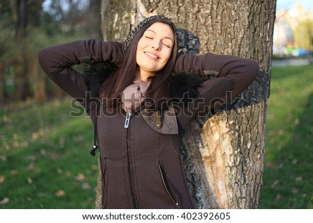 Girl taking sun in park