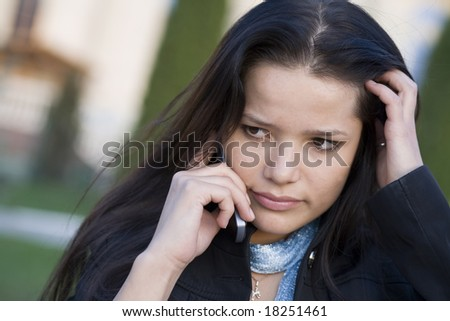 Girl  talking by phone - stock photo