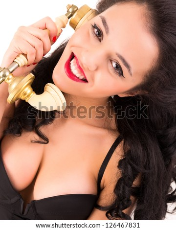 girl talking old phone with white background