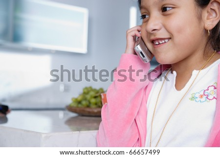 Girl talking on mobile phone - stock photo