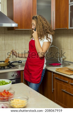 girl talking on the phone in the kitchen