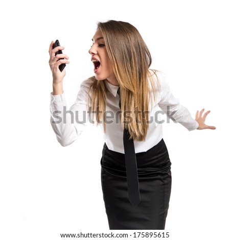 Girl talking to mobile over isolated background.  - stock photo