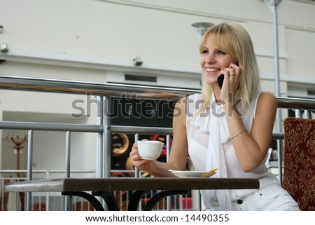 girl talks on mobile telephone
