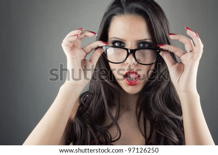 Girl teacher with eyeglasses and red lips - stock photo