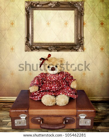 Girl Teddy Bear on a Suitcase with Frame for your Portrait - stock photo