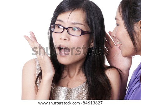 Girl telling a secret to another - gossip isolated over a white background - stock photo
